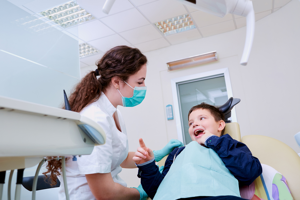 child with dentist in dental chair